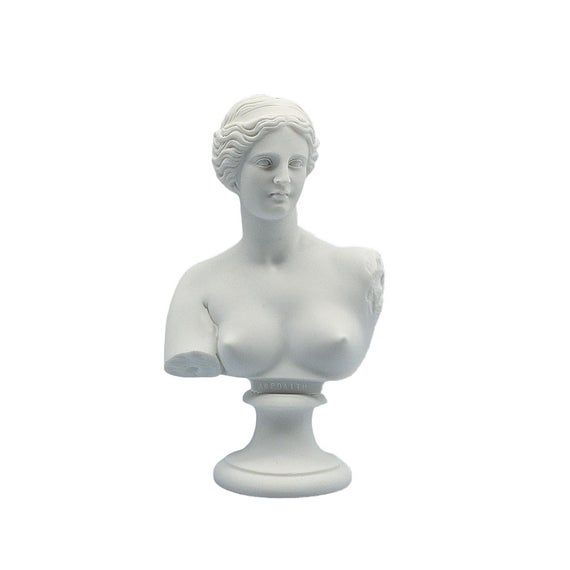 """Aphrodite Venus Bust Sculpture Ancient Greek Roman Mythology Goddess Handmade Replica Statue SpecificationsHeight15cmWeight450grMaterialMARBLECategory Marble, Sculptures, Statues, Greek Roman MythologySHIPPINGWorldwide Shipping with Free Tracking NumberHANDMADE PRODUCTTraditionally made with the method of casting MarbleAphrodite, ancient Greek goddess of sexual love and beauty, identified with Venus by the Romans. The Greek word aphros means """"foam,"""" and Hesiod relates in his Theogony that Aphrod"""