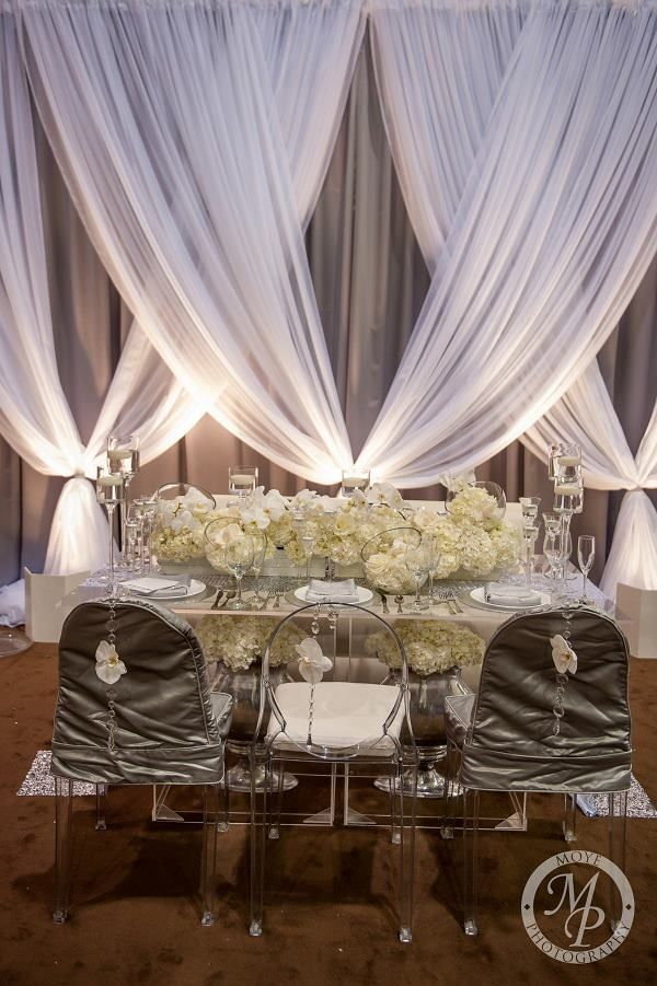 White and ivory reception table Wedding Ceremony Arch www.tablescapesbydesign.com https://www.facebook.com/pages/Tablescapes-By-Design/129811416695