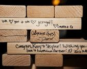 Giant Jenga Wedding Guest Book by Tumbling Timbers Handmade from new 2x4 SOLID wood. $100.00, via Etsy.