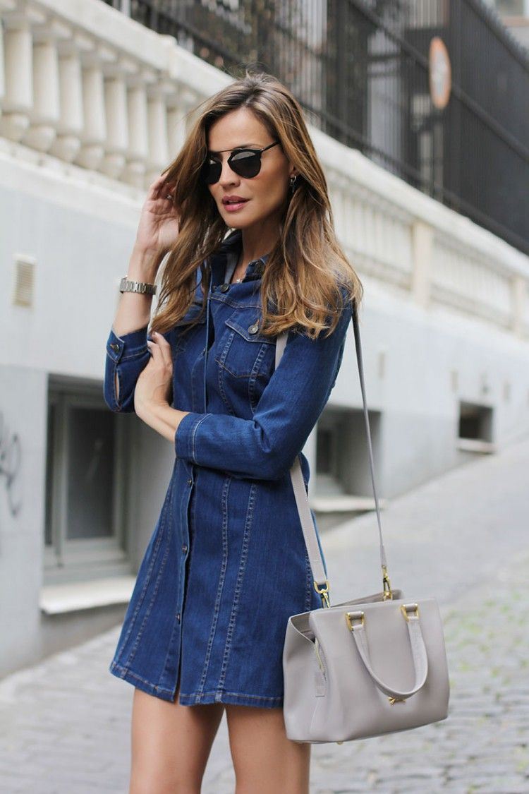 75e92ececc Via Just The Design  Silvia Garcia is wearing a long sleeved denim dress  from Zara with a pale grey Longchamp bag