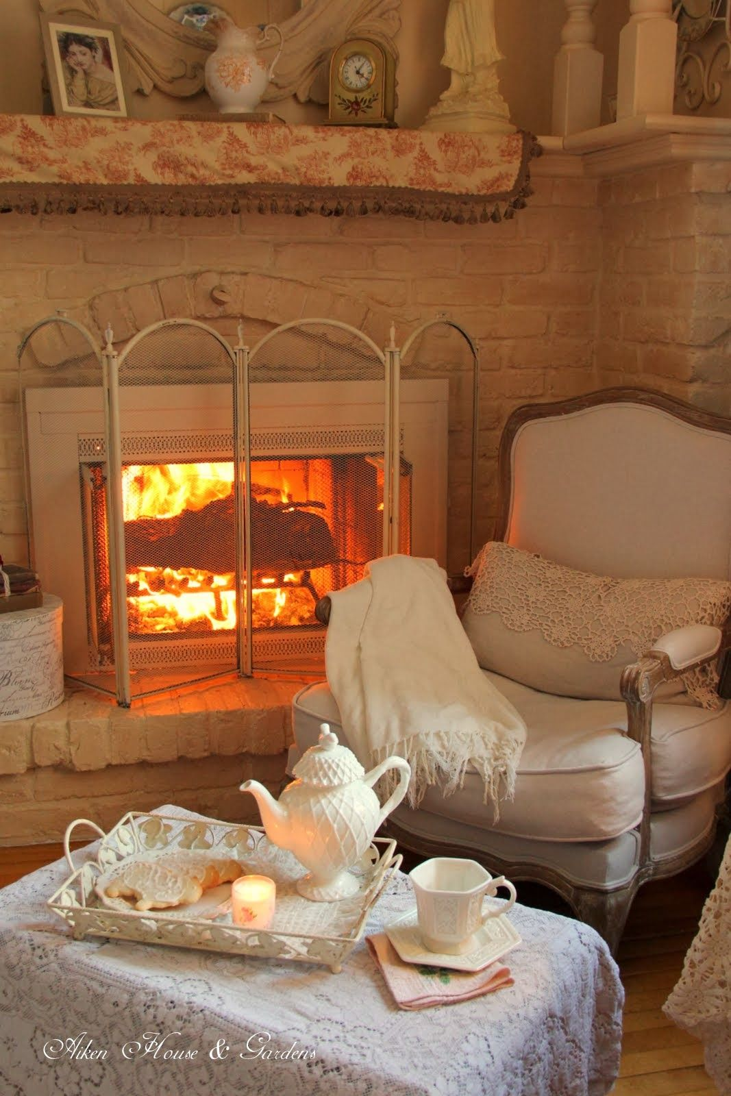 A fireside tea And I love the white surround of the fireplace