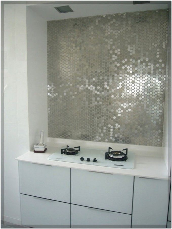 Fascinating Mirrored Tile Backsplash With White Kitchen Cabinet And Cooktop Also White Countertop For Modern Kitchen Idea
