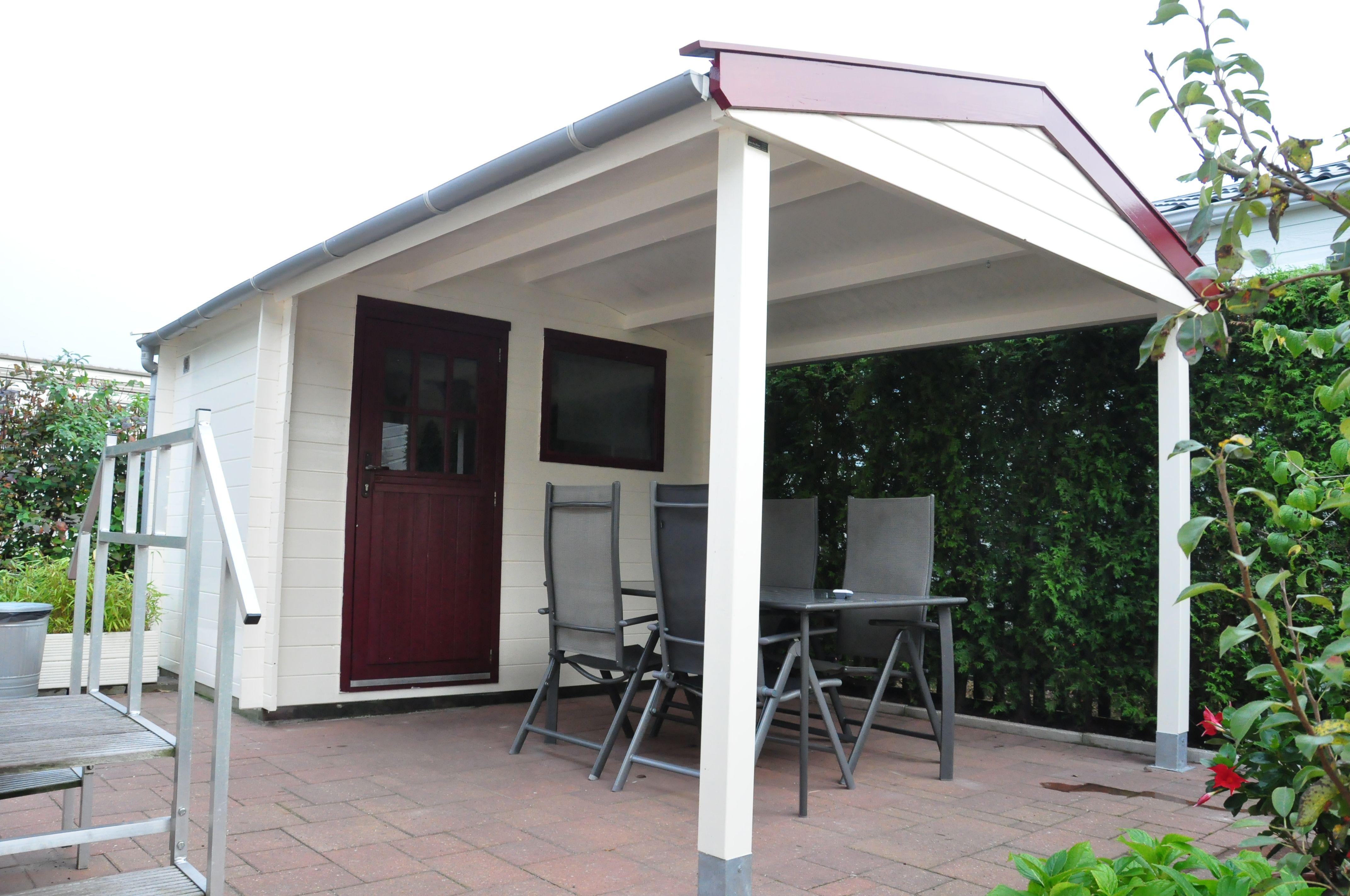 Dak van tuinhuis vervangen en verlengd veranda overkapping