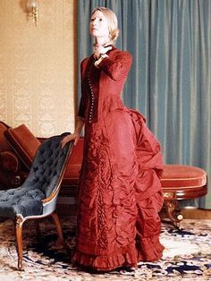 Day dress, IW Caley, Norwich, England, ca. 1880. Maroon silk. Bodice has velvet trim, is lined and boned. Bustled skirt. Pinned from artfact.com