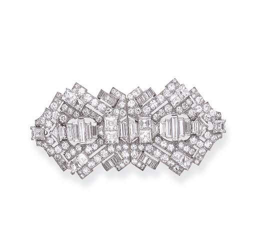 AN ART DECO DIAMOND BROOCH   Designed as an old European-cut diamond openwork shield-shaped plaque, enhanced by vari-cut diamonds, mounted in platinum, circa 1925, in a red leather case