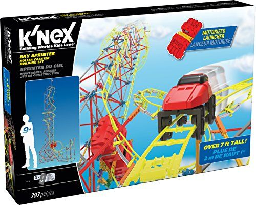 """Reach for the sky with the Sky Sprinter Roller Coaster Building Set - our tallest Roller Coaster ever! Build with 796 K'NEX pieces including classic rods, classic connectors, and track! Use the included blaster motor to shoot the red coaster car to a height of 7 feet! Then watch it wind it's way down the track to complete it's journey! For more fun, download instructions for an exclusive 2nd coaster. Requires 3 """"AAA"""" batteries (not included). Rods and connectors Made in the USA. Ag..."""