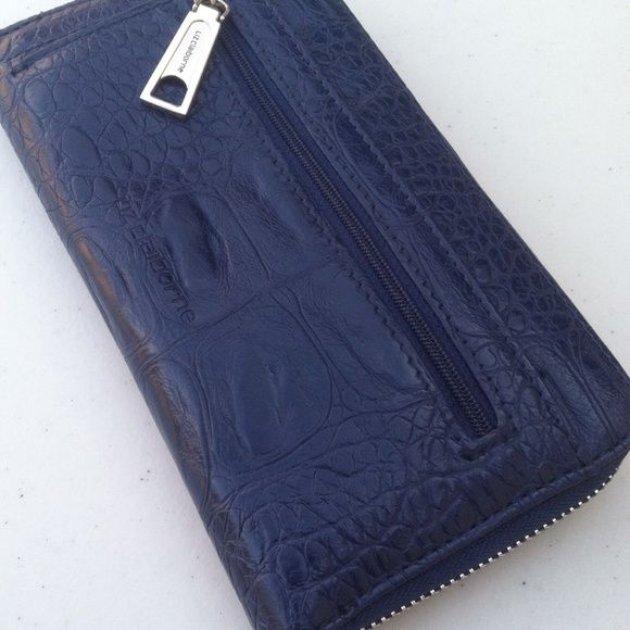 Lid Claiborne Wallet Dark Blue Liz Claiborne Wallet never used but has a line on the back. Showing on pictures. This print goes with dark or mutuel colors. Liz Claiborne Accessories