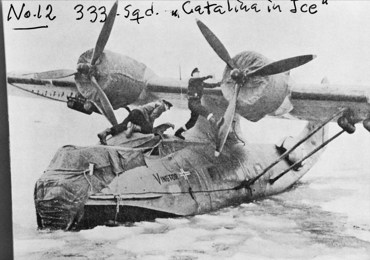 Removing tarps from a Catalina Flying Boat, Norway, WWII