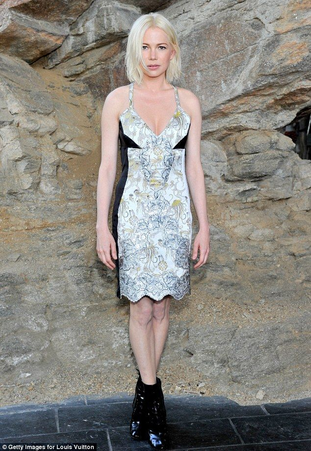 1205f85d4cb7 Chic  Michelle Williams sizzled in a patterned slip dress and black  booties... Blonde bombshell  Michelle Williams hit the Louis Vuitton Cruise 2016  Resort ...