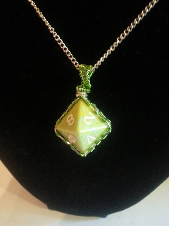 Wire wrapped dungeons and dragons gamer dice jewelry available in my Etsy shop https://www.etsy.com/listing/518620554/green-wrapped-dice
