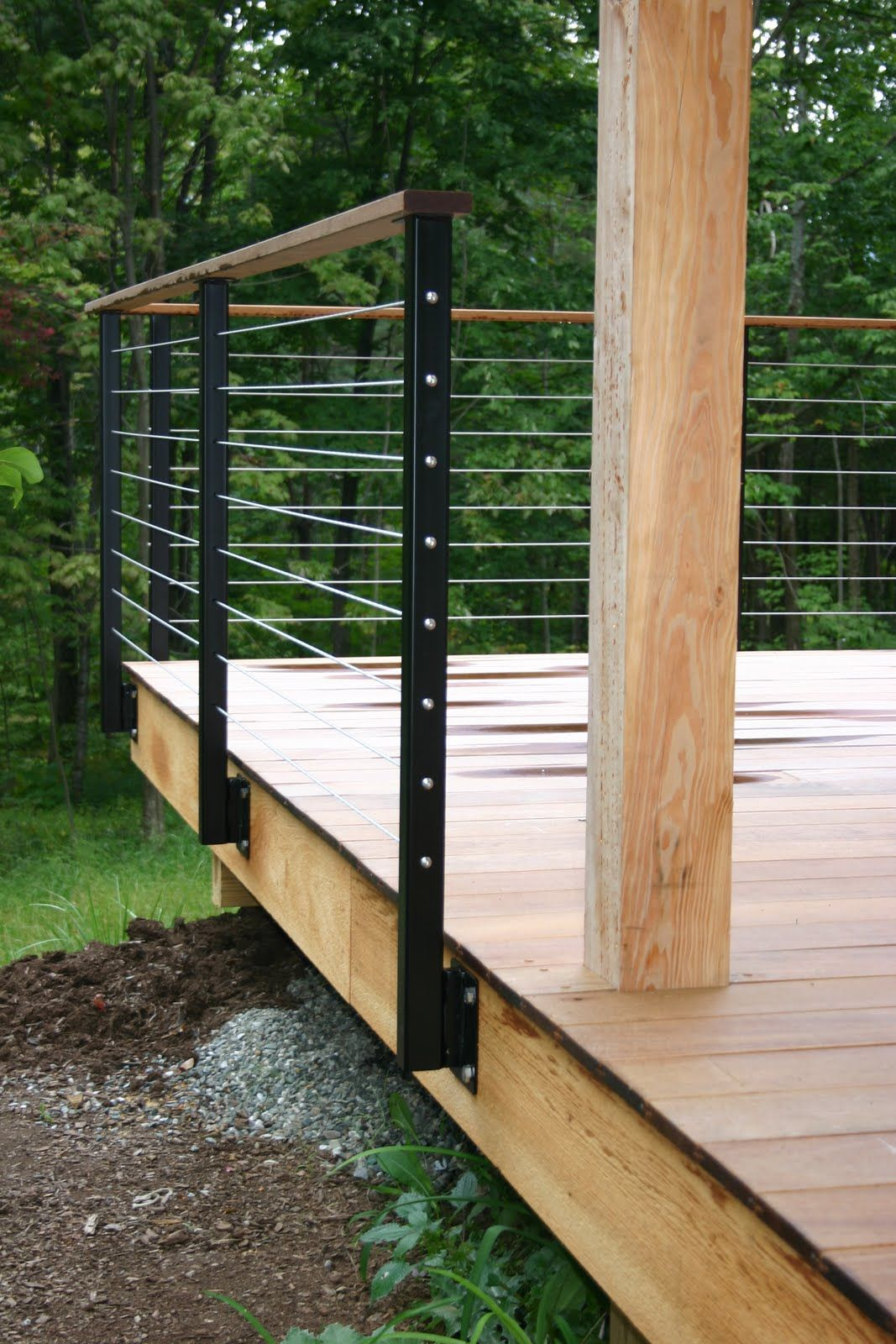 modern cabin: deck railing, metal railing posts, wire, wood