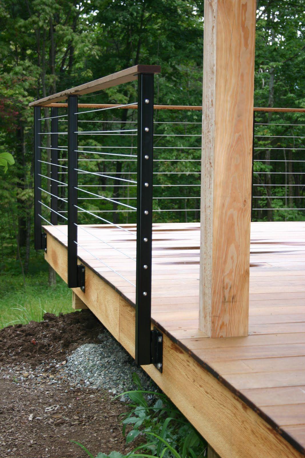 modern cabin: deck railing, metal railing posts, wire ...