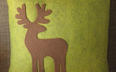 Almohadón navideño con diseño de reno