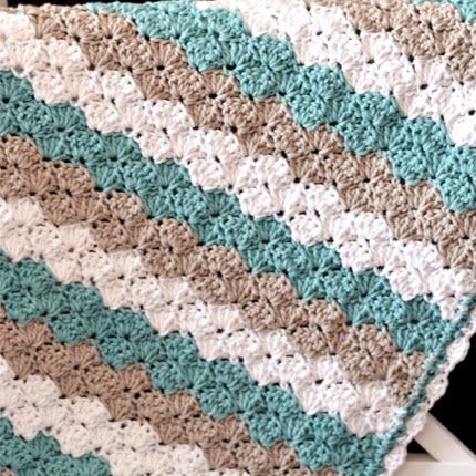 Shell stitch baby blanket free pattern crochet ideas this sea shell stitch baby blanket has a clean nautical look that any new parents would love crochet baby blanket patterns should be timeless and elegant dt1010fo