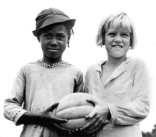 It was a hard time, during the Great Depression, but friends could still be found. We aren't born with prejudice. We learn it; or we learn to love our neighbors . . . Dorothea Lange Photo
