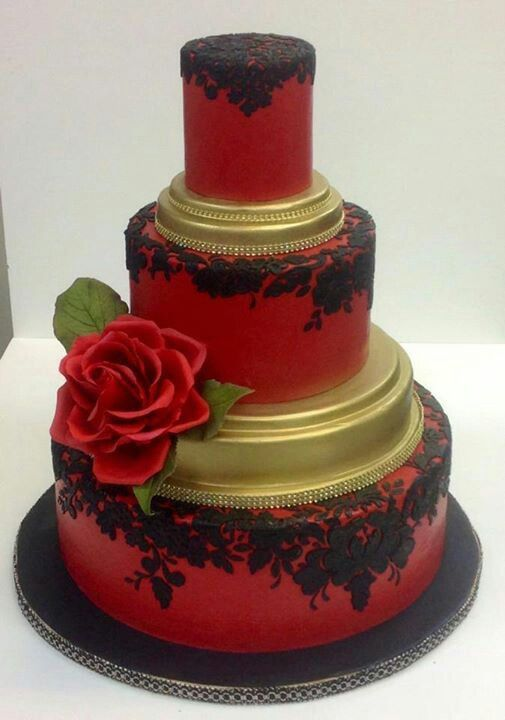 Red Frosted Cake With Gold Black Trim Topped With A Red Rose