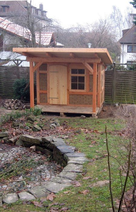 Garden house from halftimbered larch with mud brick from