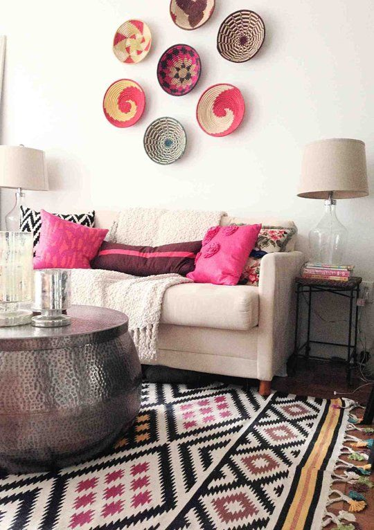 Fun Living Room With Color, Pattern, And Texture. Love The Pillows And The  Rug. Cool Pounded Metal Coffee Table And Colored Baskets Mounted On The  Wall.