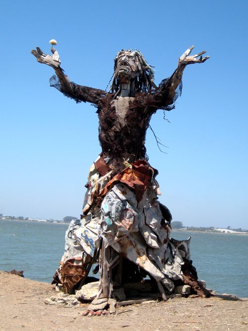 trash art made at oil spill cleanup