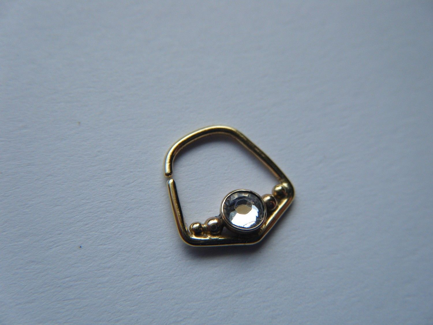 Yellow nose piercing  Yellow Gold Angles Septum Ring with Stone  Ink and piercings