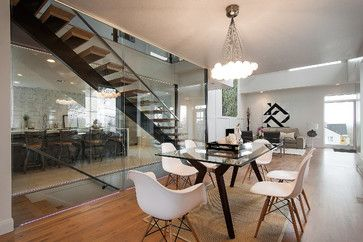 The Glass Enclosed Staircase Divides The Kitchen And Dining Room While Still Maintaining An Open Airy F Glass Dining Table Glass Top Dining Table Table Design