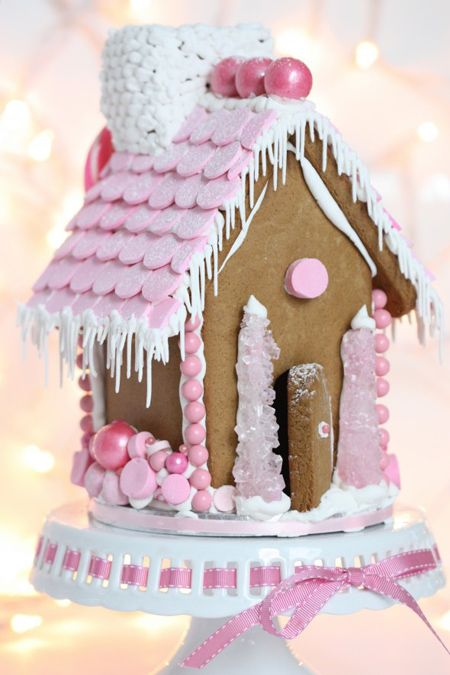 Beautiful pink gingerbread house with pink and rock candy pink trees