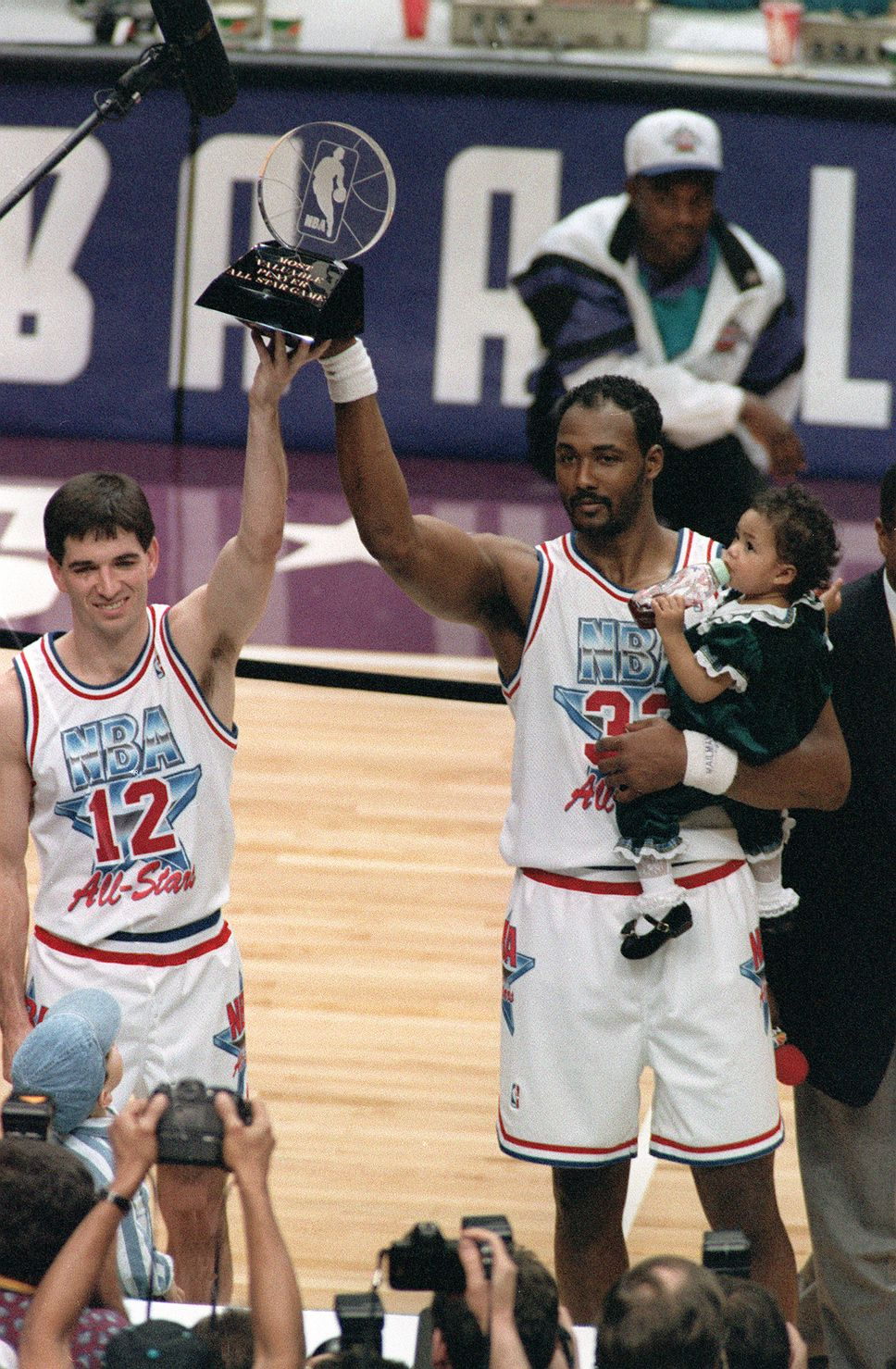 69e7fba885b Utah Jazz teammates and co-Most Valuable Player winners John Stockton,  left, and Karl Malone hold up the All-Star MVP trophy after playing for the  West team ...