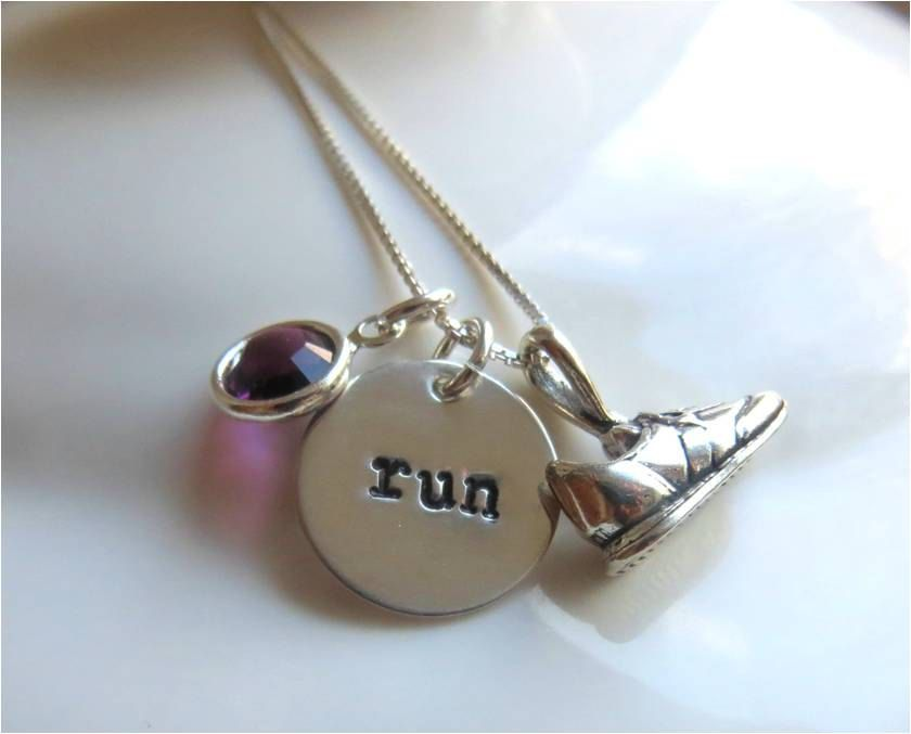"Shiny new running necklace! Running sterling silver necklace with hand stamped ""run"" charm, sneaker charm and Swarovski crystal of your choice. $32.00, via Etsy."