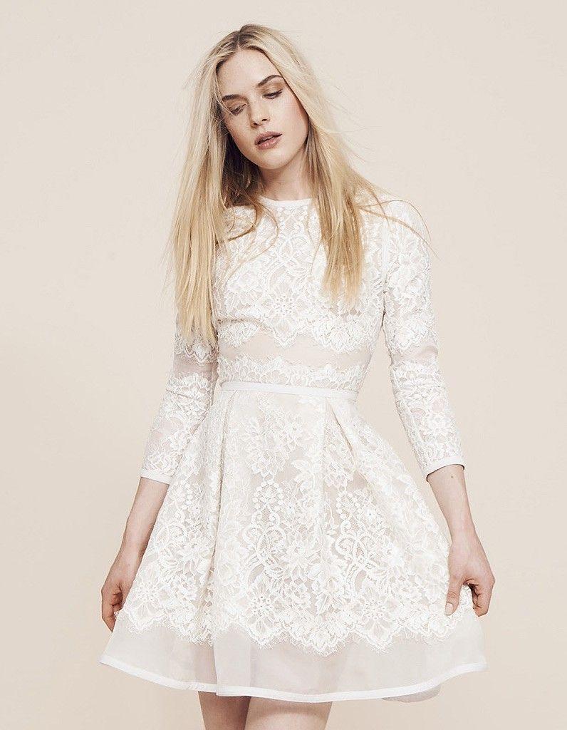 a8da64ab497 Les plus belles robes de mariée courtes - ELLE   Robe de mariée courte  printemps-été 2015 Elie Saab chez Maria Luisa Mariage