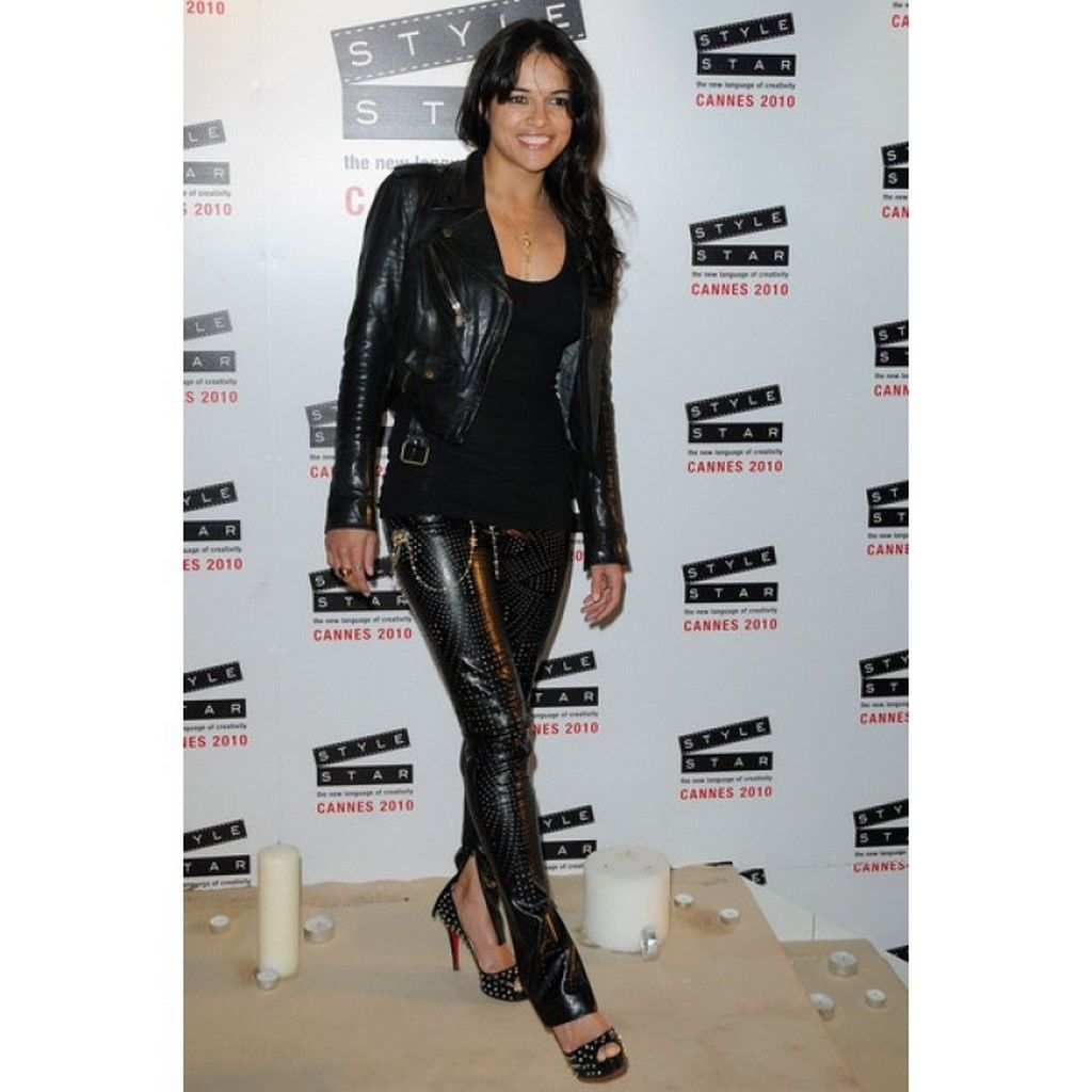 Michelle Rodriguez Leggings - Michelle wore a skin-tight pair of  side-zipper, perforated black leggings.