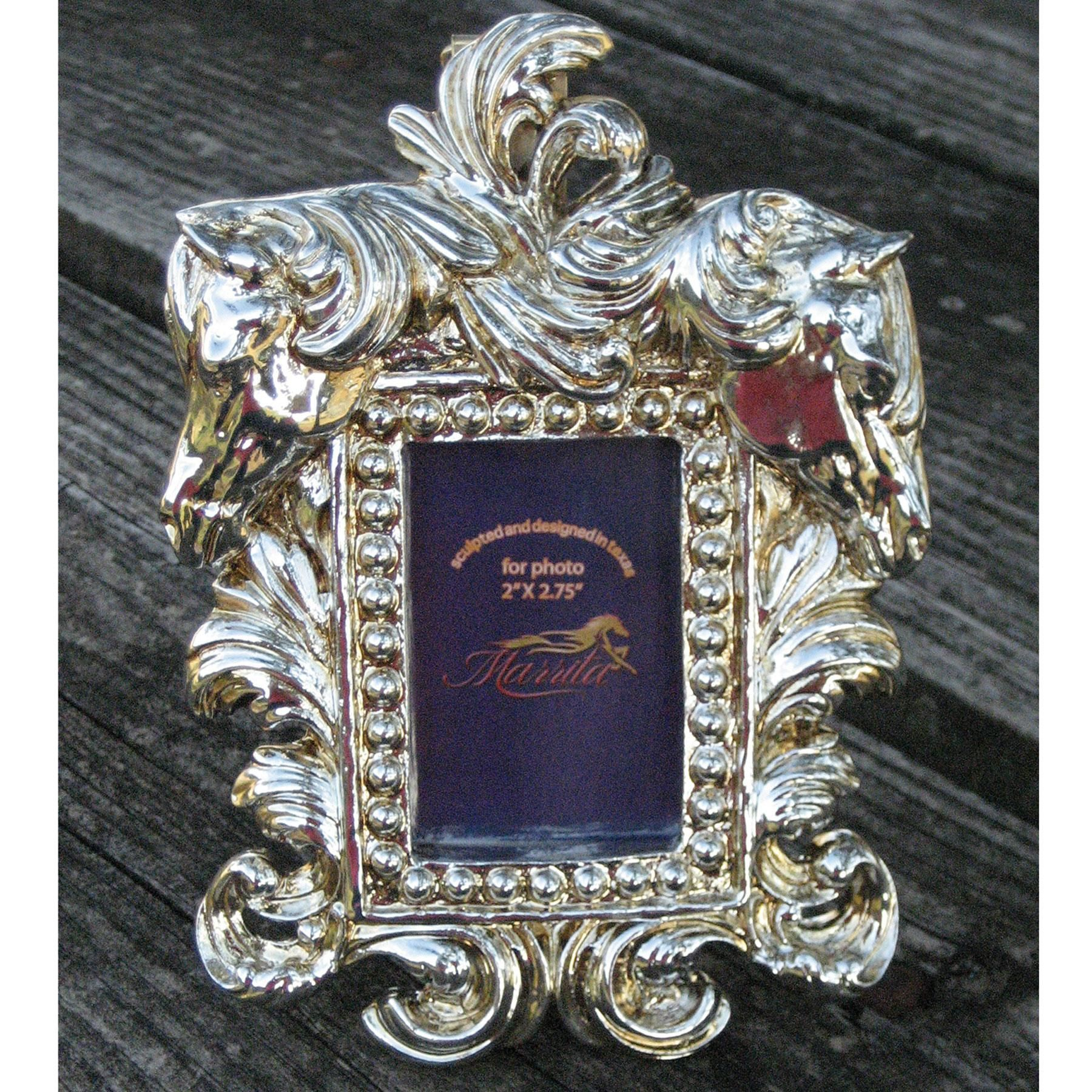 """Remember your beautiful picture in this beautiful Marrita Zita Frame. These beautiful horses with Rococo stylized metallic manes are ever present to protect your photos or award. Fits any 2"""" x 5"""" photo. Makes the perfect gift for any horse lover."""