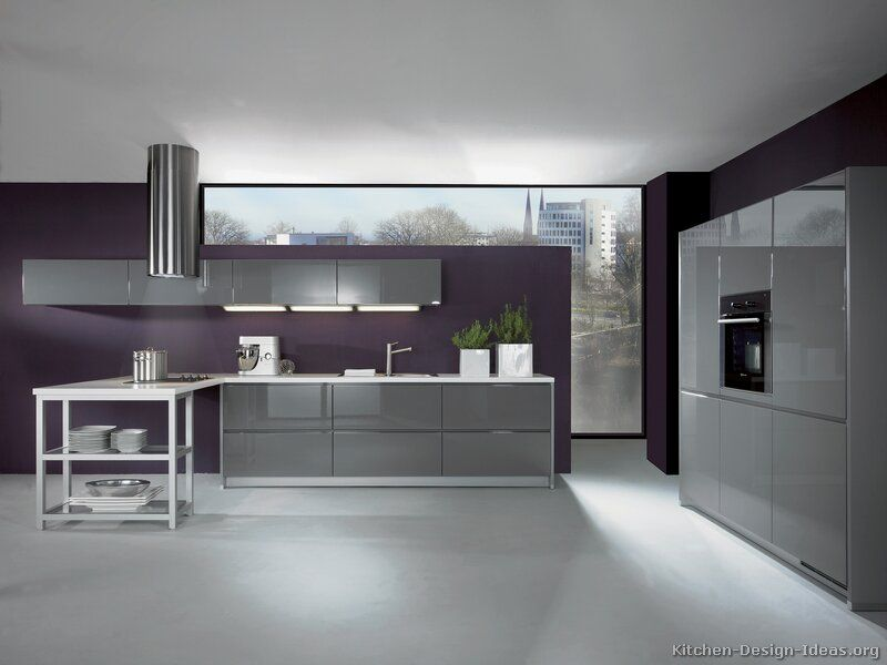 Sleek modern kitchen i 39 m loving the eggplant colored wall for Modern kitchen wall color ideas