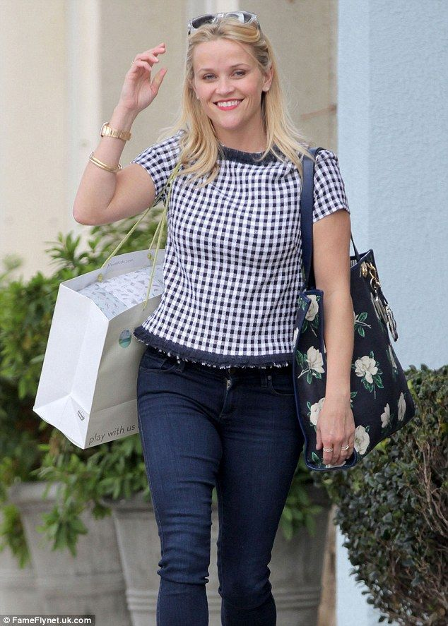 Conservative chic: The blonde beauty wore the navy Tweed Nashville Shirt...