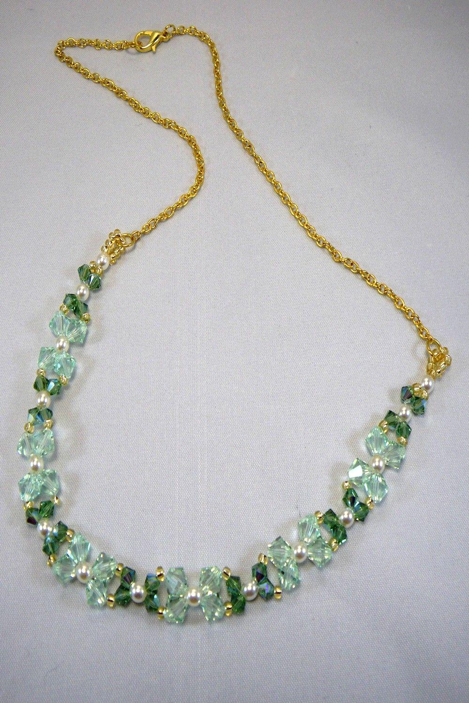 Collier en perles toupies cristal swarovski vert et chaîne plaqué ...