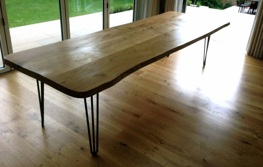 solid oak dining table with contemporary iron legs by sandman planters | notonthehighstreet.com