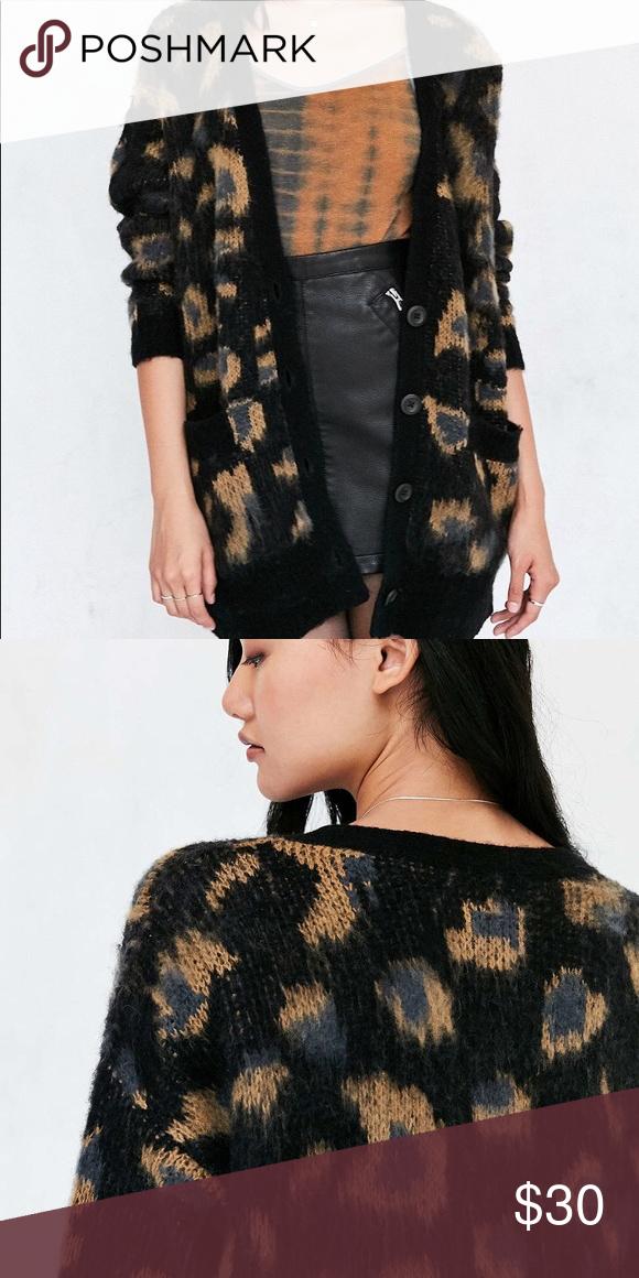 23e76532ed29 Leopard Print Cardigan Brushed leopard print oversized boyfriend cardigan.  Ecote Sweaters Cardigans