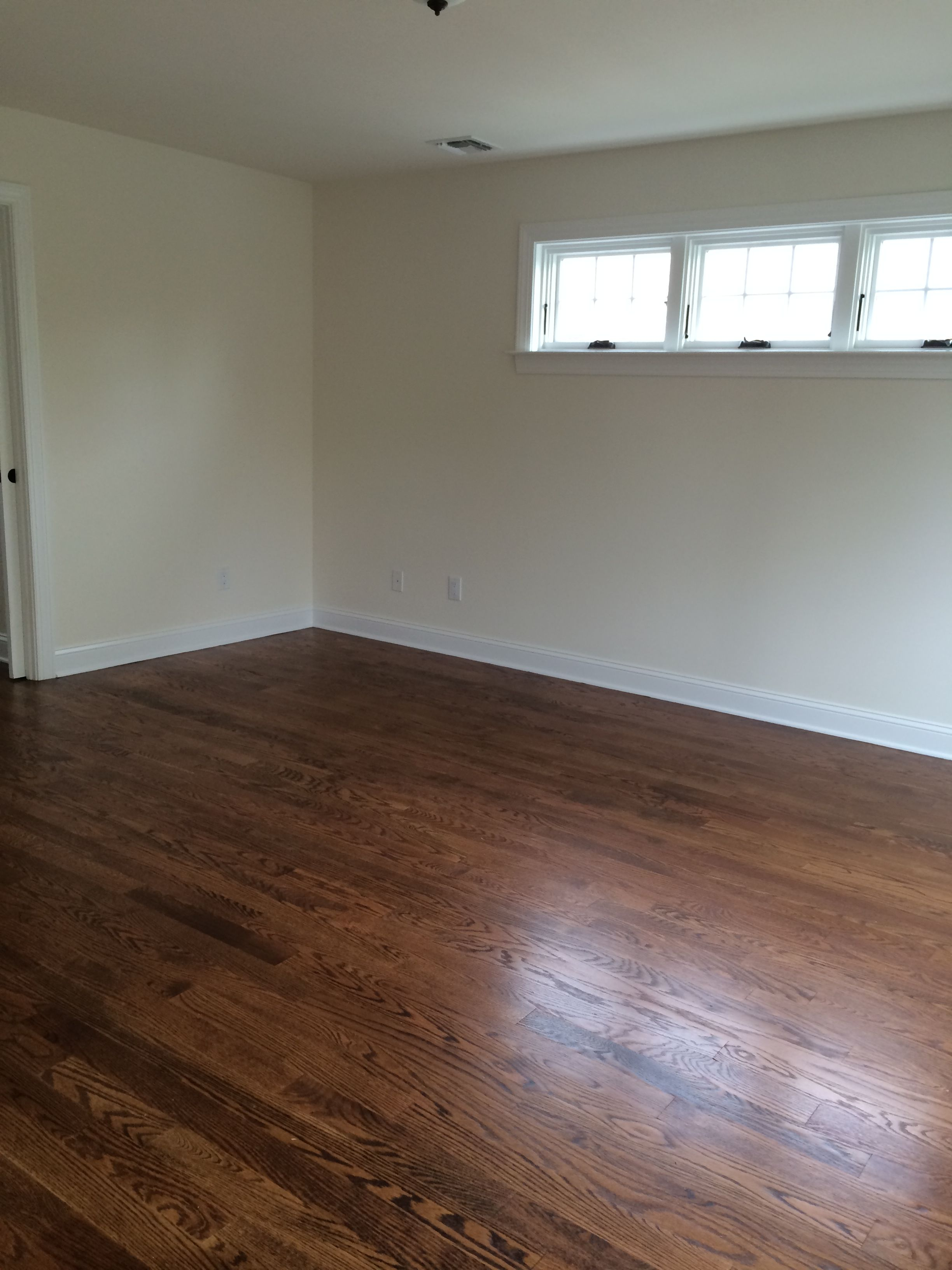 A view of an upstairs room of the rumson house with wood floors and