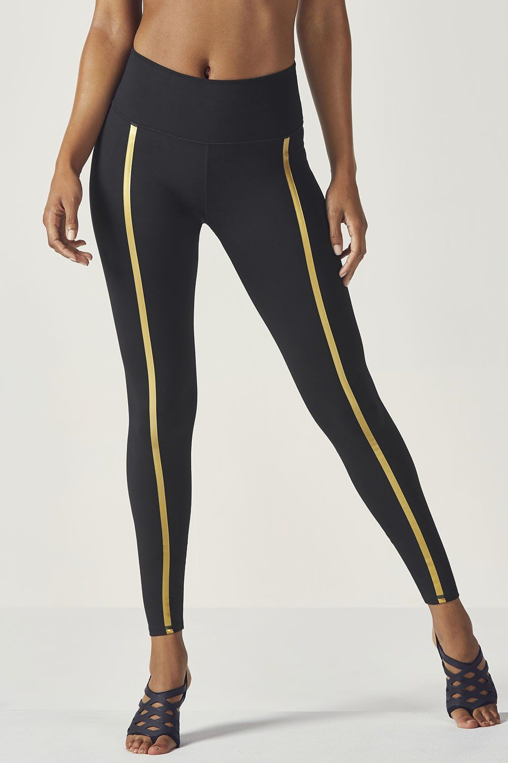 33023d68e084bf Day or night, this head-turning performance legging is made to be seen with  reflective gold trim and a flattering high-rise waist.