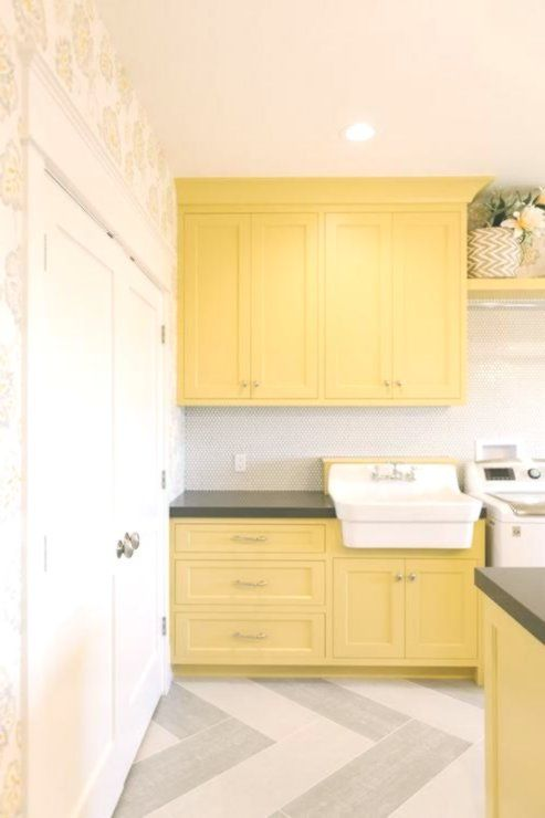 Yellow and gray laundry room features yellow shaker cabinets paired with charcoa... - #cabinets #charcoa #features #gray #Laundry #paired #Room #shaker #yellow #graylaundryrooms