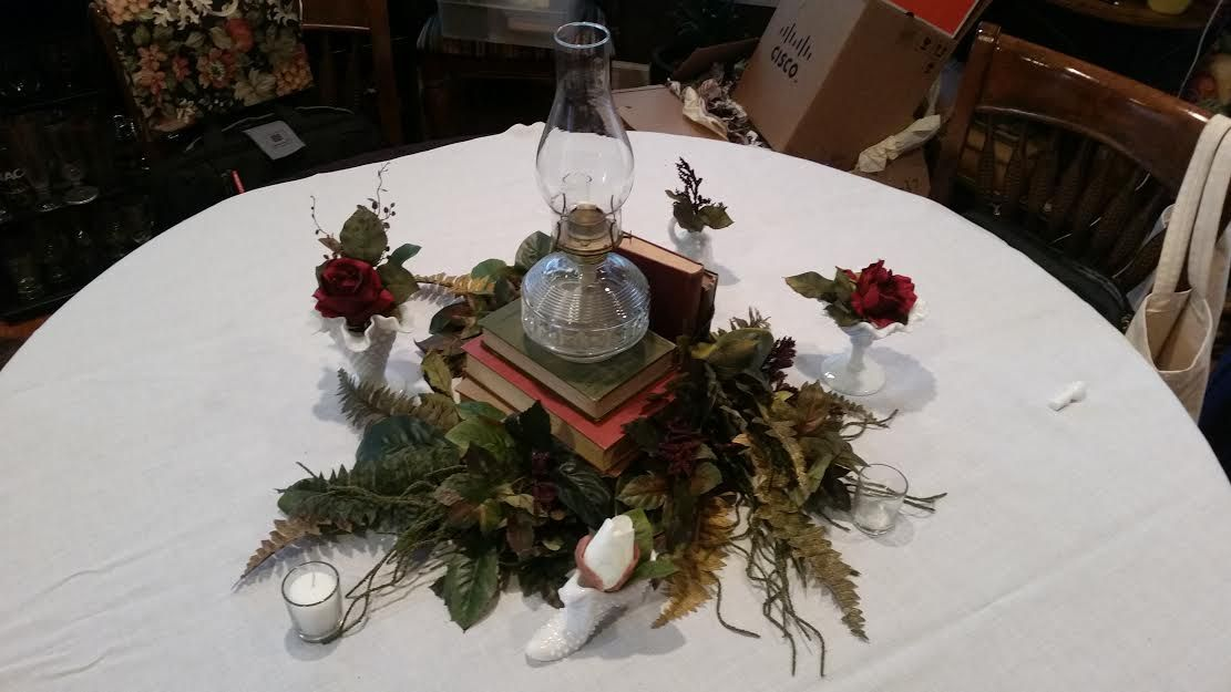 kind of a mock up of a table centerpiece...some ferns and magnolia leaves with some flowers and tiny arrangements in milk glass.