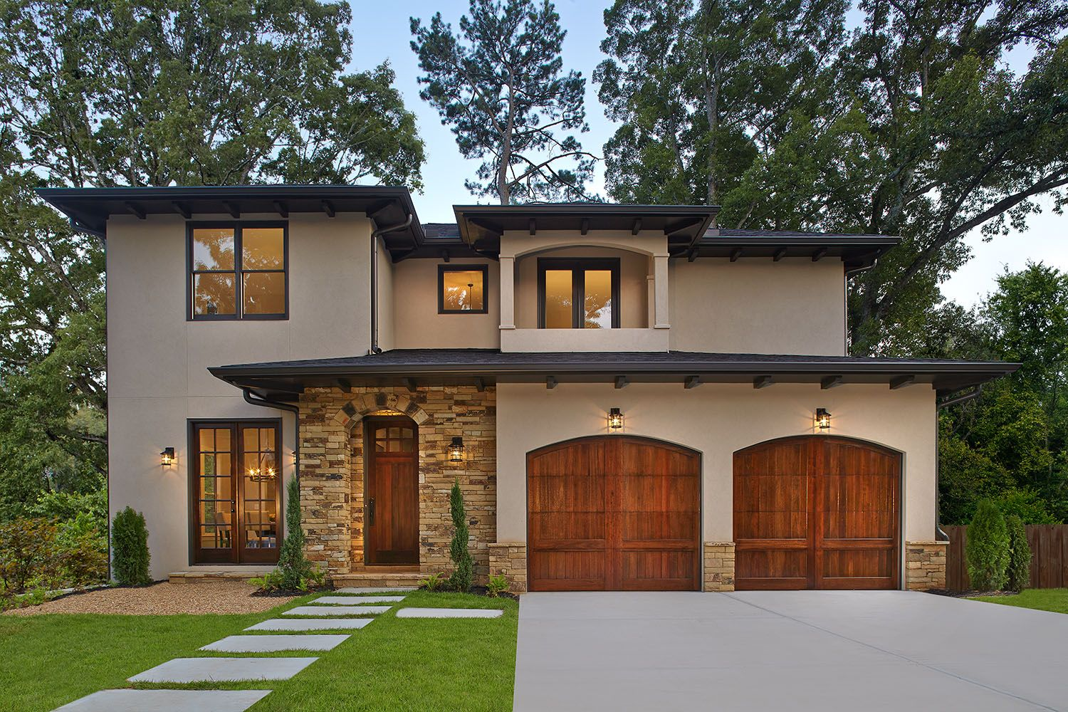 Clopay Reserve Collection Wood Carriage House Style Garage Doors Add Warmth And Character To This Mediterranean Homes Exterior Mediterranean Homes House Styles