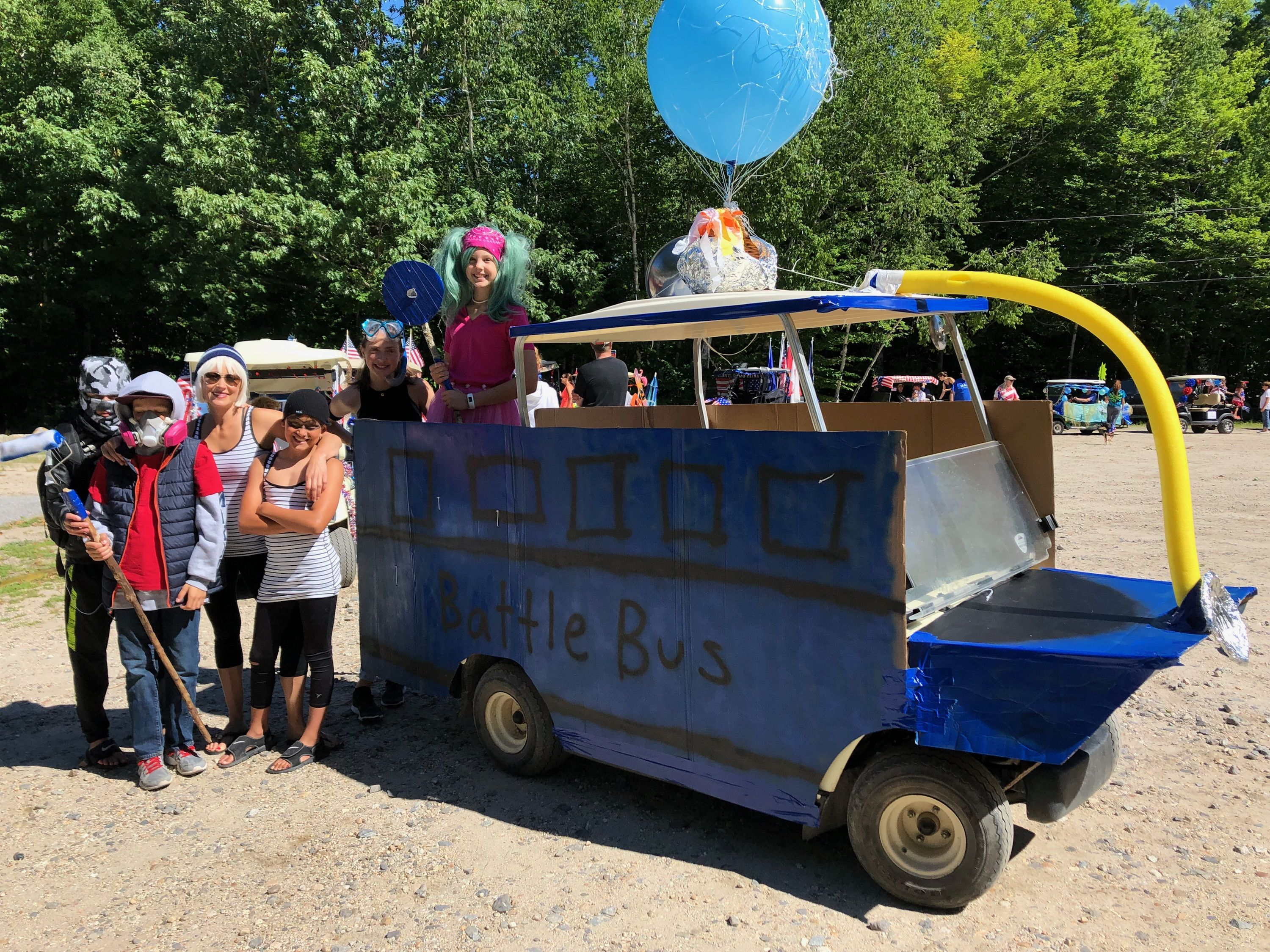 Fortnite Golf Cart parade float: Zoe, Abstract, Havoc, Snorkel Ops on floating golf game, floating golf hole, floating van, floating generator, floating tank, floating utv, floating golf green,