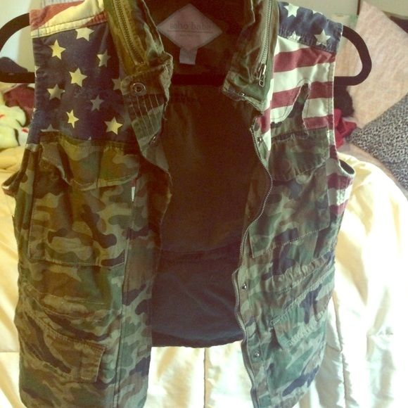 Army vest Never been worn it has draw stings at the waist so you can cinch it  in and it comes with a hoodie for those days when it's cold or windy (size is labeled as medium )  Soho babe Jackets & Coats Vests