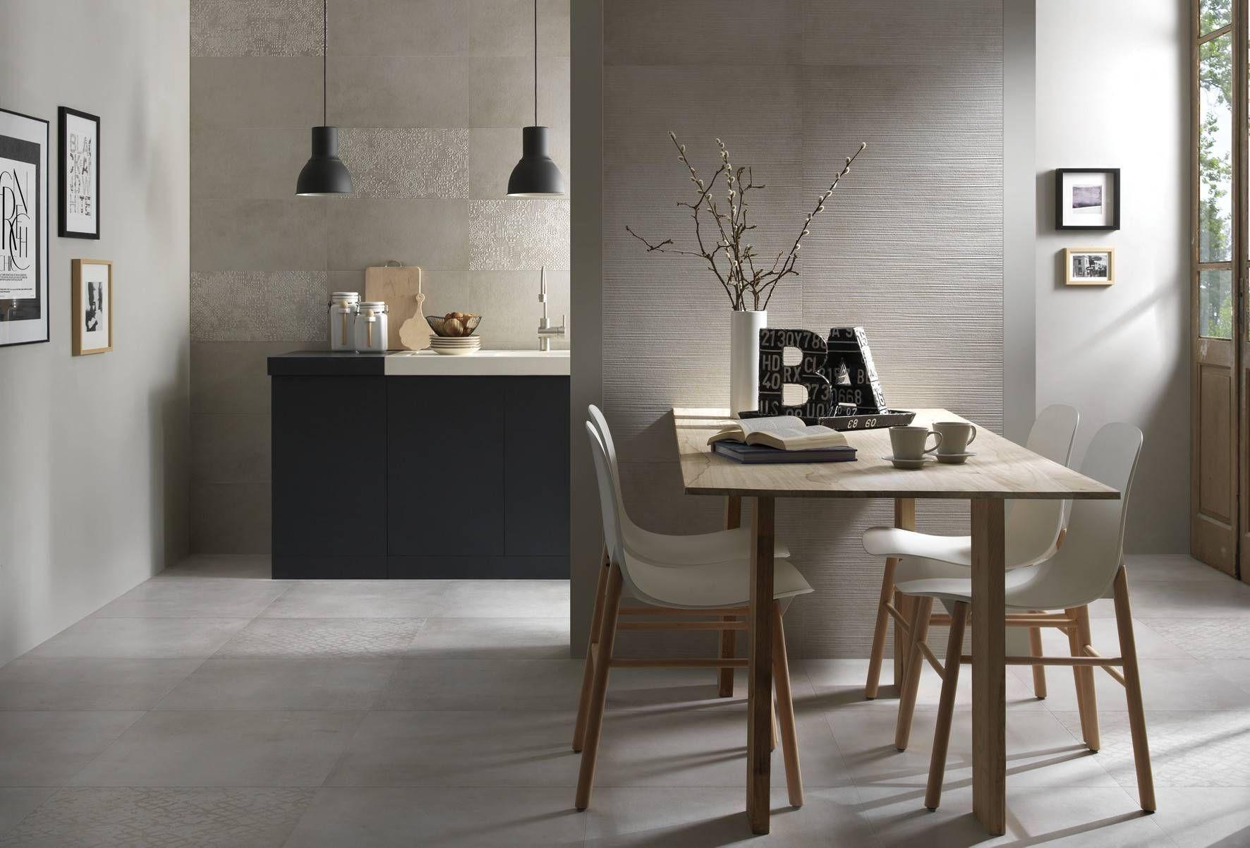 In questa ambientazione una cucina moderna e minimale, dalle linee ...