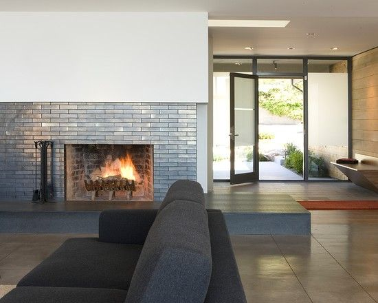 Cool Contemporary Entry With Charming Modern Brick Fireplace Ideas