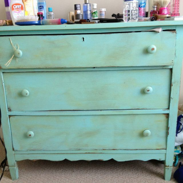 Create a old dresser into a colorful masterpiece