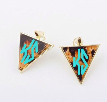 The Dagger Earring is a larger, triangle-shaped goldtone french back post earring with brown leopard print resin and a gold spike at the top. $12.95  #monogram #vinyl #custom #initials #preppy #gift #personalized #classic #love #wedding #bridesmaids #tortoiseshell #spike #leopard #animalprint #dagger #triangle #earring