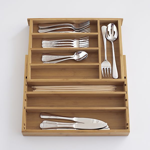 expandable bamboo flatware tray in utility storage crate and