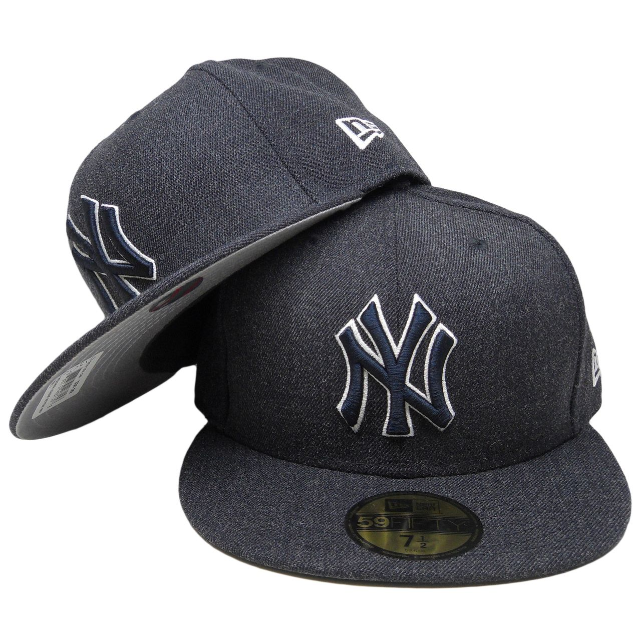 440d09da60546 New York Yankees MLB fitted hat from New Era Heather League Collection  features woven acrylic and wool in all dark navy with