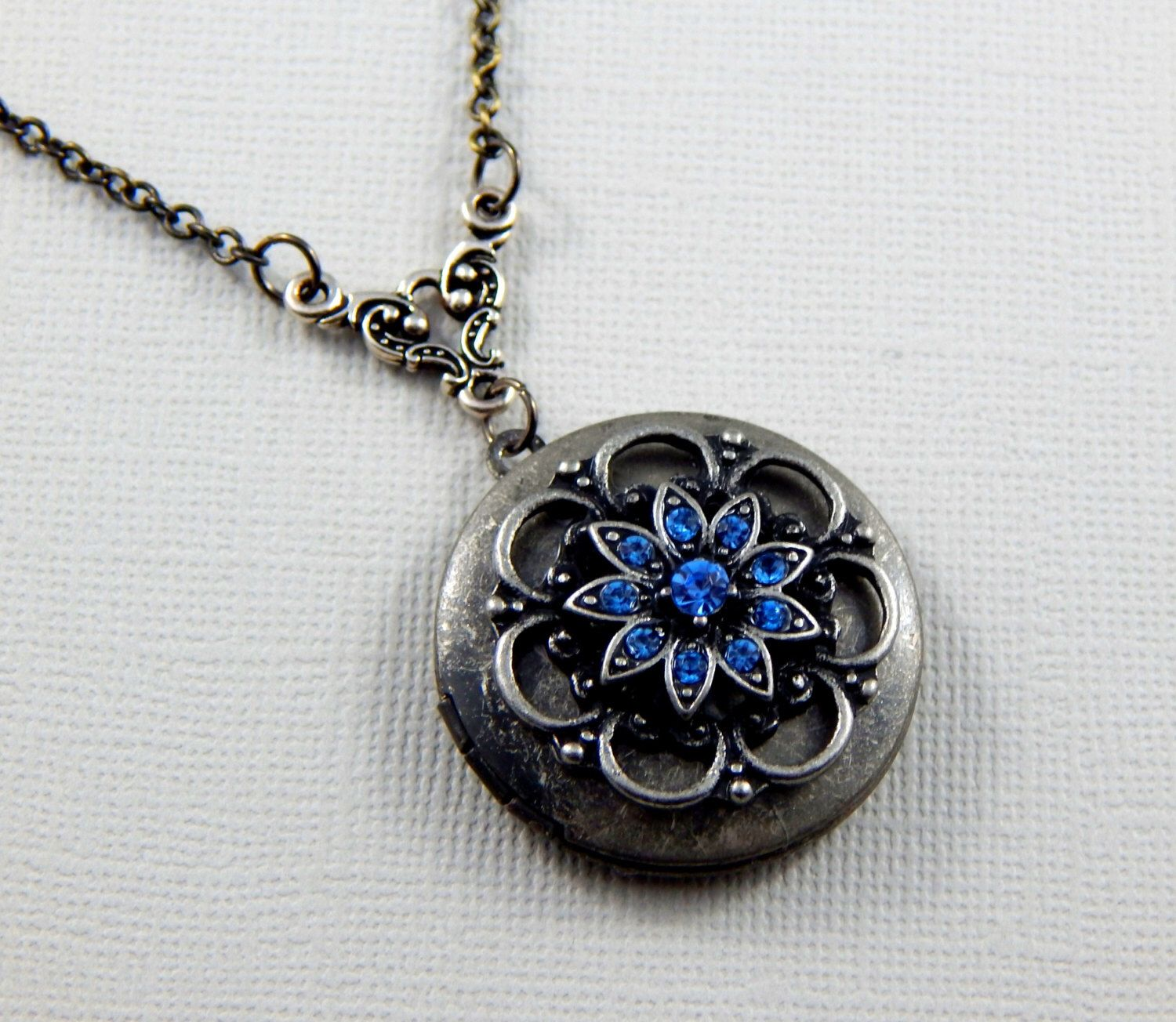 Sapphire Lace Flower Locket Antique Silver Locket Round Silver Birthstone Locket Opening Locket by Kikiburrabeads on Etsy https://www.etsy.com/listing/240100390/sapphire-lace-flower-locket-antique